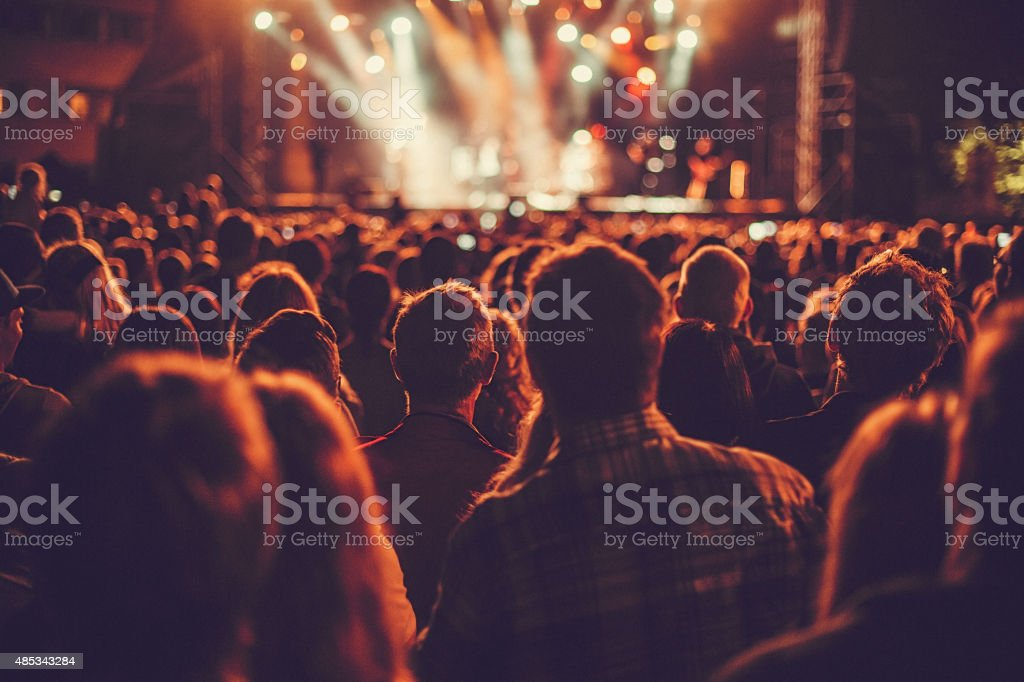 Big concert audience listening to music stock photo