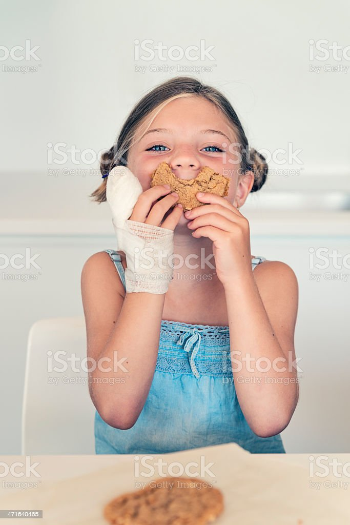 Big cookie smile for an injured little girl. royalty-free stock photo