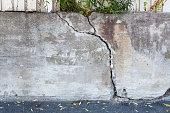 Big crack concrete wall outdoors