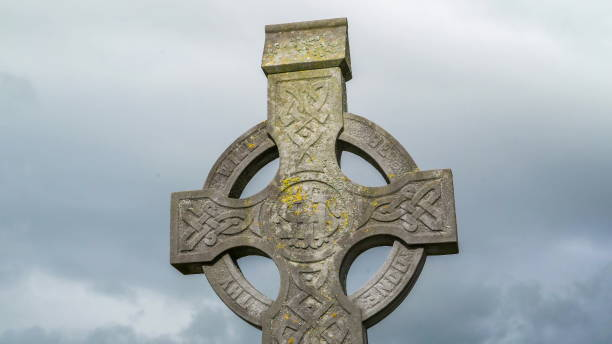 Big cross tomb inside the cemetery Ireland Big cross tomb inside the cemetery found on the tombs in the cemetery portal dolmen stock pictures, royalty-free photos & images
