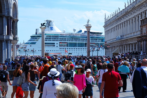 A big cruise ship is passing, front of St. Marco square, Venice