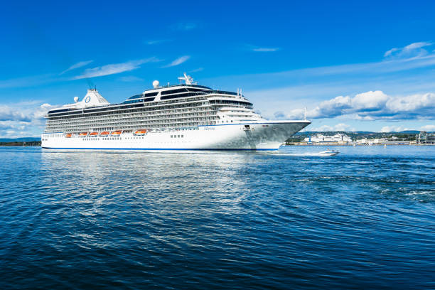 A big cruise ship overtaken by a speedboat in Oslo fjord, Norway A big cruise ship overtaken by a speedboat in Oslo fjord. Oslo, Norway, August 2018 norwegian culture stock pictures, royalty-free photos & images
