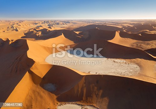 Aerial Panorama at sunset of the famous Big Daddy Sand Dune, Sossusvlei, Namib Desert, Namibia. With its 325m it is one of the highest Sand Dunes in the world. You can see the famous Dead Vlei on the right clay bed. Nikon D850. Converted from RAW. Huge Panorama.