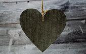 istock Big dark wooden heart on the dark wooden background 1127548538
