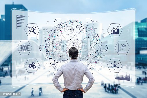 Big data analytics visualization technology with scientist analyzing information structure on screen with machine learning to extract strategical prediction for business, finance, internet of things