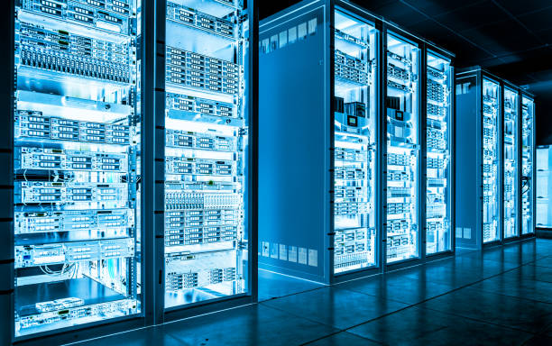 Big data dark server room with bright equipment stock photo