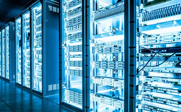 Big data dark server room with bright equipment stock photo