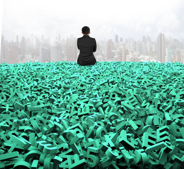 Big data, rear view businessman sitting on huge green characters stock photo