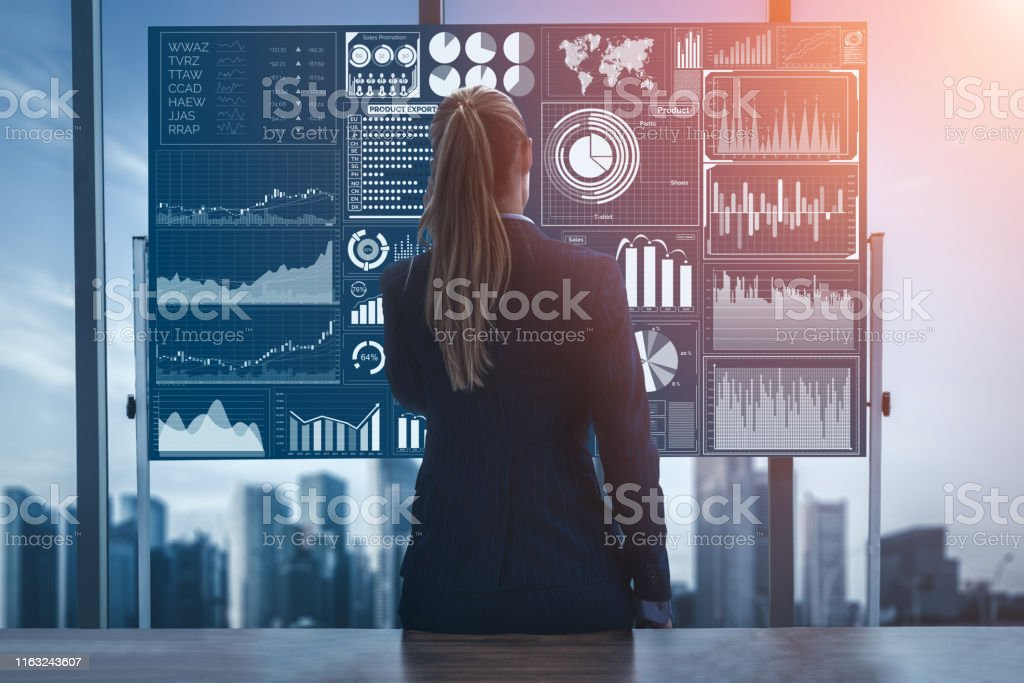 Big Data Technology for Business Finance Concept. Business analyst marketer look at big data report on computer screen analyzing and research global stock market exchange trend. Concept of futuristic information technology for business decision make. Adult Stock Photo