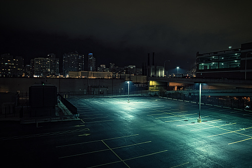 Big deserted urban city parking lot and garage at night in Chicago.
