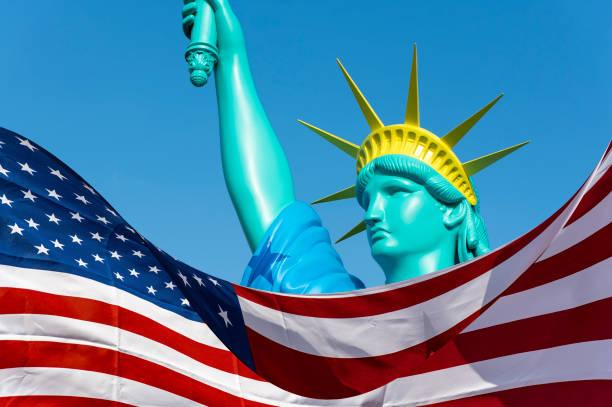 Big doll like statue of liberty and flag of the usa picture id815247942?b=1&k=6&m=815247942&s=612x612&w=0&h=pvpo2rdpryuo15zt6zh7k7dlvxpmughoypayjyz2hru=