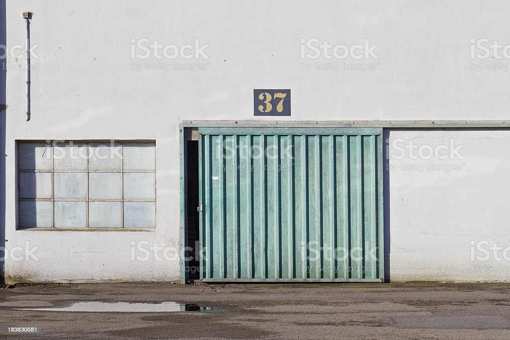 Big door in an old factory stock photo