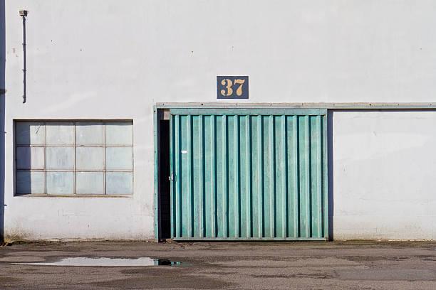 Big door in an old factory stock photo