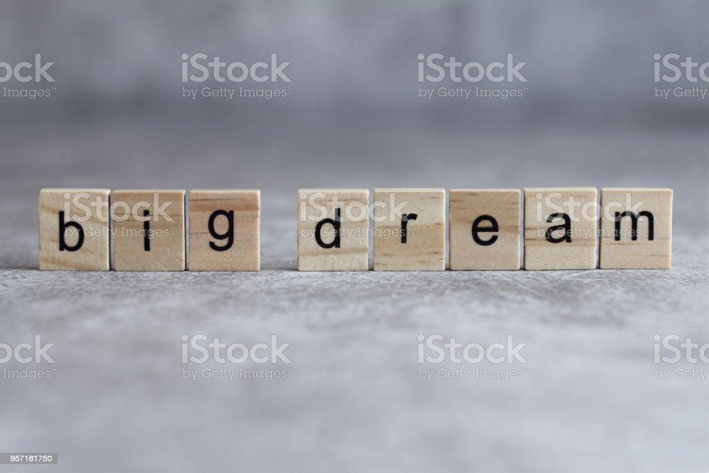 Big dream word written on wood cube stock photo