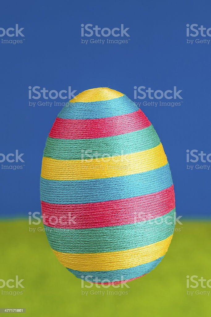 Big easter egg on green and blue background. stock photo