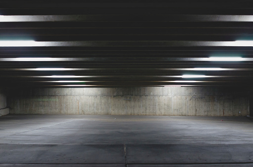 istock A big empty parking garage under the lights 1037207566