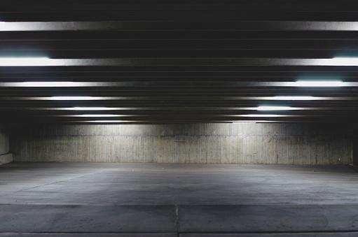 A big empty parking garage under the lights