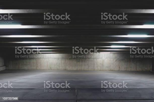 Photo of A big empty parking garage under the lights