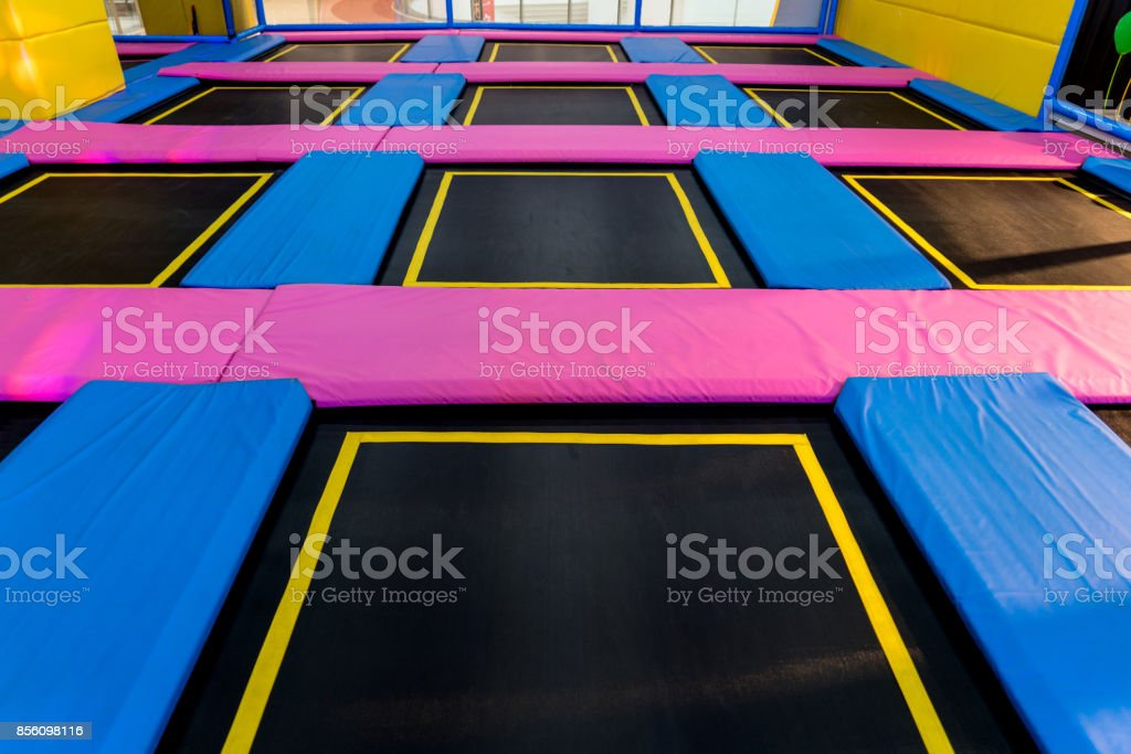big empty trampoline waiting for children, lean place big empty trampoline waiting for children, lean place Childhood Stock Photo