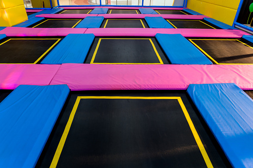 Big Empty Trampoline Waiting For Children Lean Place Stock Photo - Download Image Now