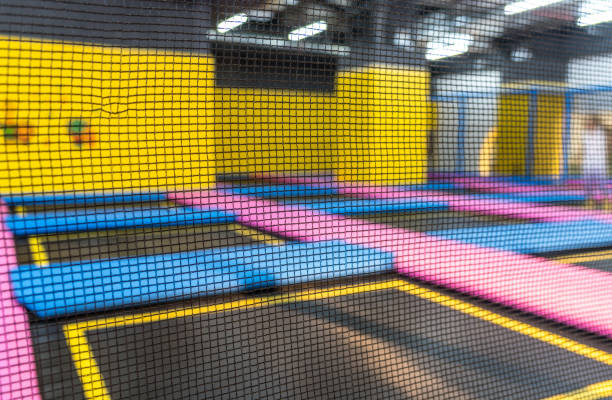 big empty trampoline waiting for children, lean place stock photo