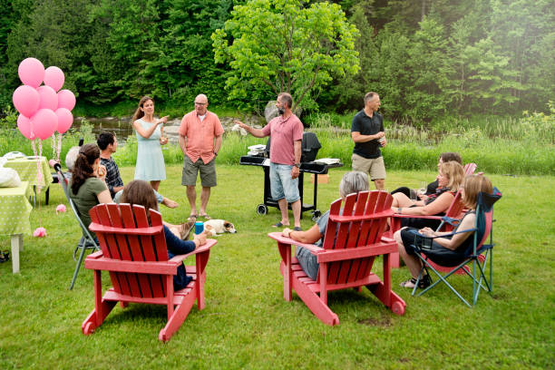 Big family at happy hour before BBQ, summer outdoors. stock photo