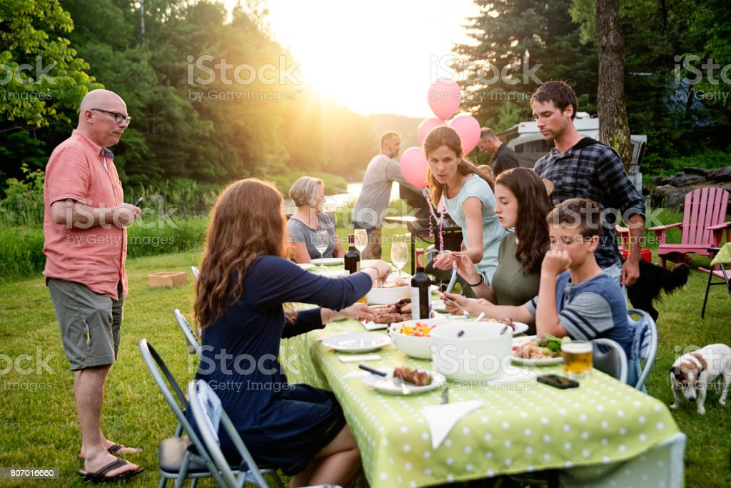 Big Family Barbecue Gathering At Sunset, Summer Outdoors. Royalty Free  Stock Photo