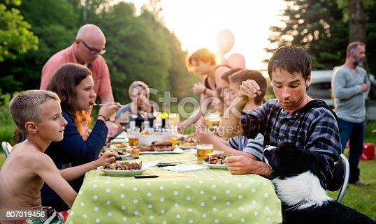 istock Big family barbecue gathering at sunset, summer outdoors. 807019456
