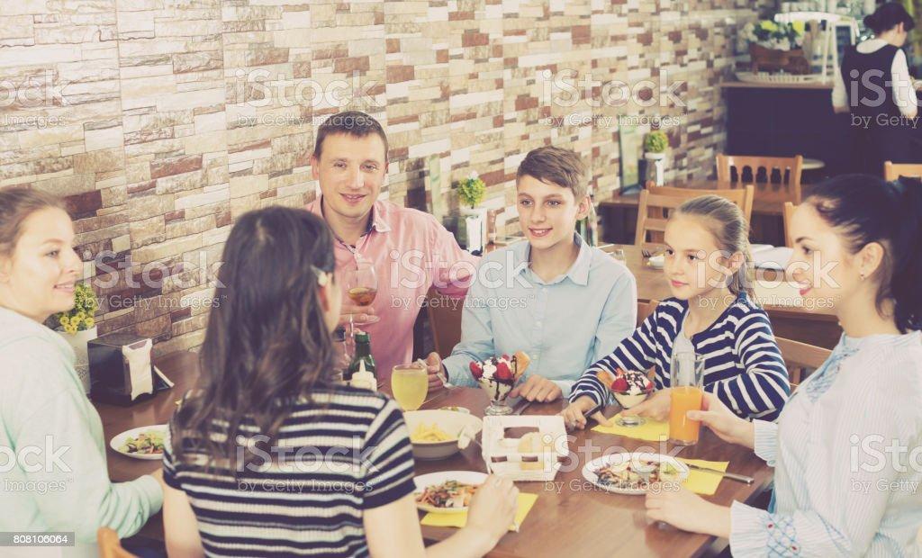 Big family having fun and dinning stock photo