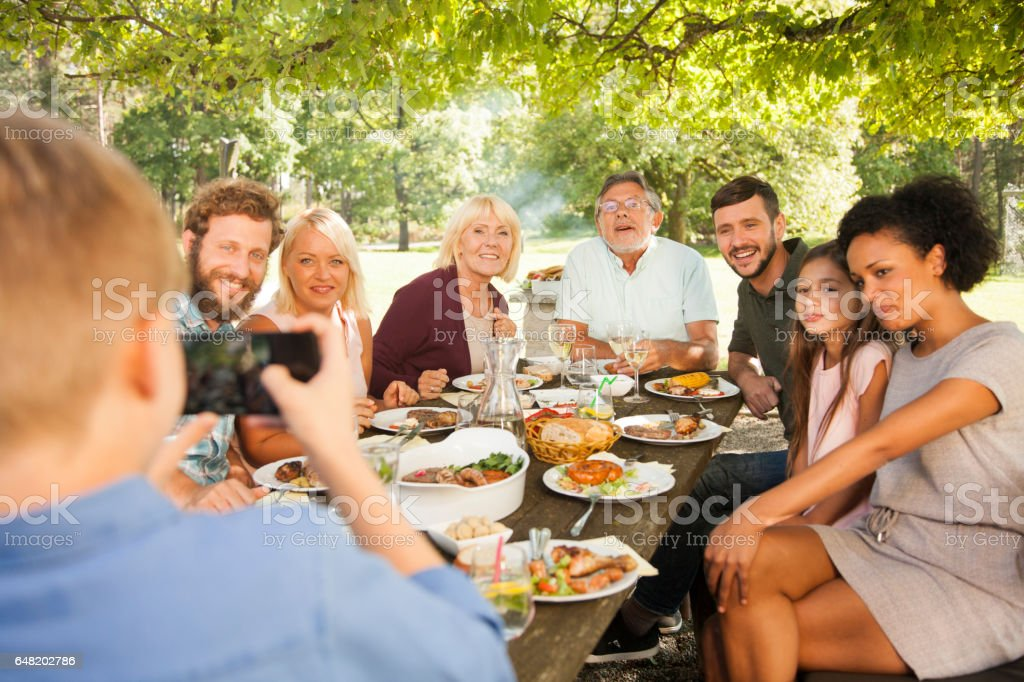 Big family taking portrait photo at picnic stock photo