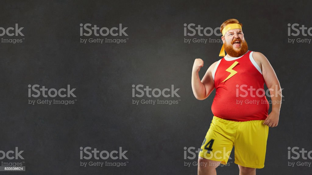 Big fat naked man in sports clothes stock photo