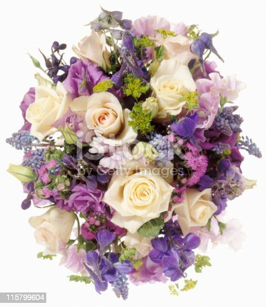 large flower arrangement or bridal bouquet with Roses and Lilacs cut out on white background