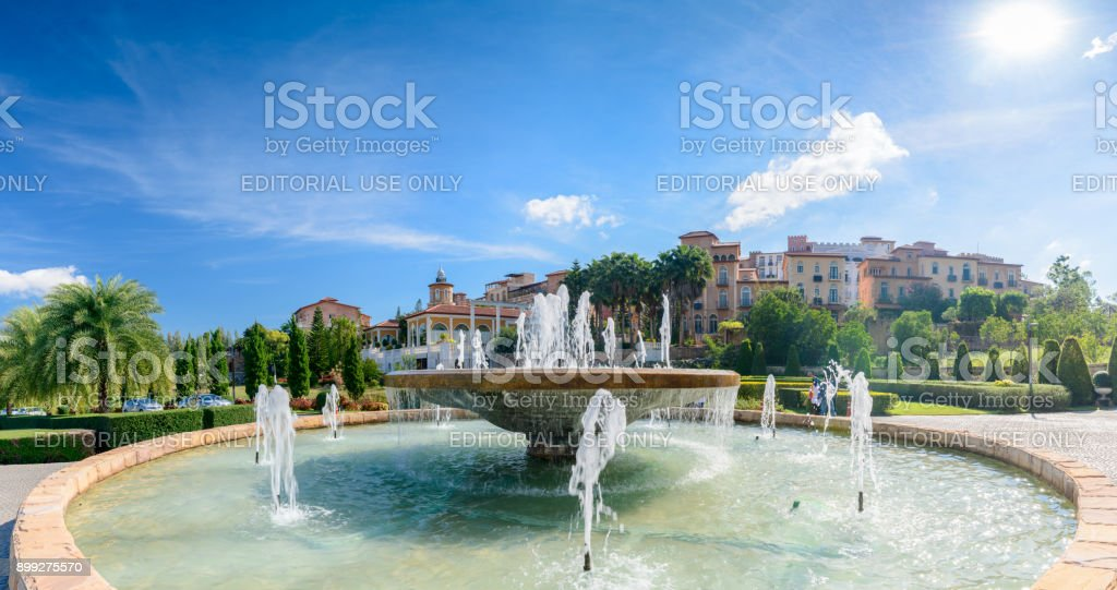 Big fountain amd Toscana valley town square italy style building decoration on background, stock photo