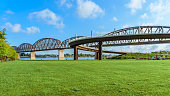 The Big Four pedestrian bridge spans the Ohio River from Louisville KY to Jeffersonville, IN.  Openned to pedestrians in 2013 the bridge was built as railroad bridge in 1895.