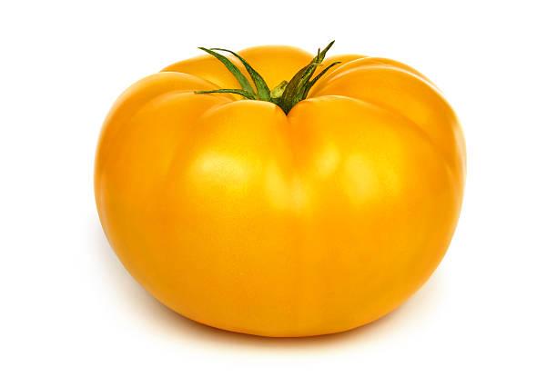 Big fresh yellow tomato. stock photo