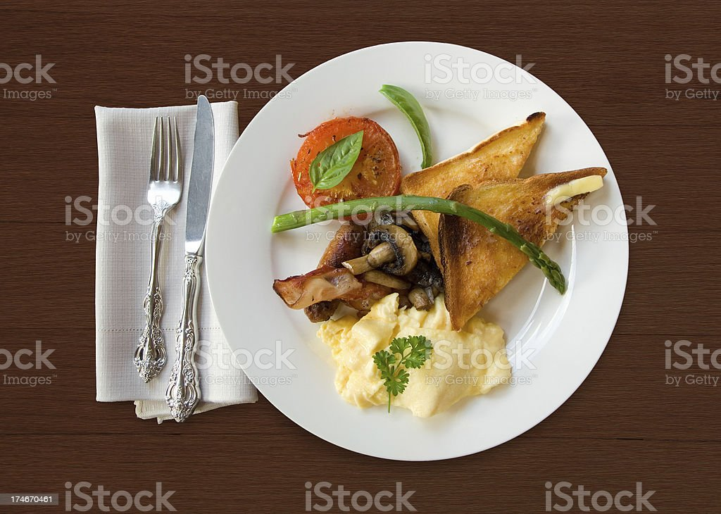 Big fried English breakfast on wooden table background royalty-free stock photo
