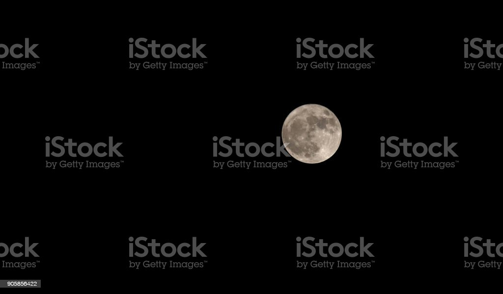 big full moon in the middle of the black sky stock photo