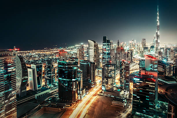 Big futuristic city with illuminated world tallest skyscrapers. Dubai, UAE. – Foto