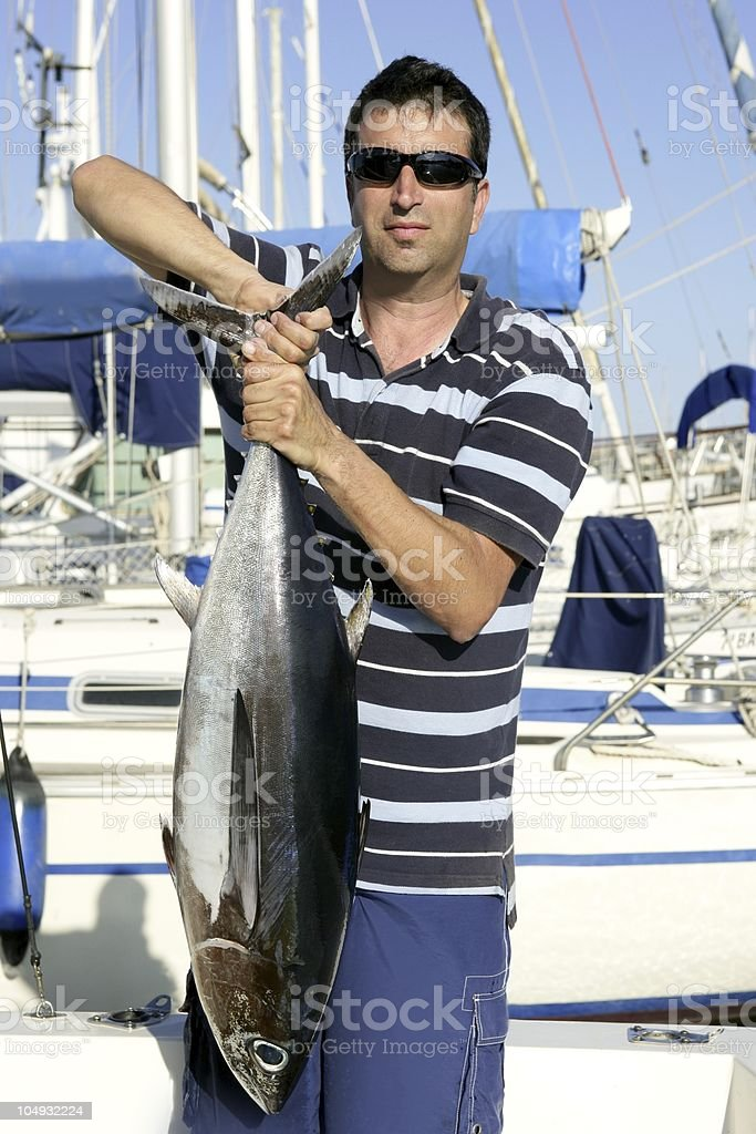 Big game fisherman with saltwater tuna royalty-free stock photo