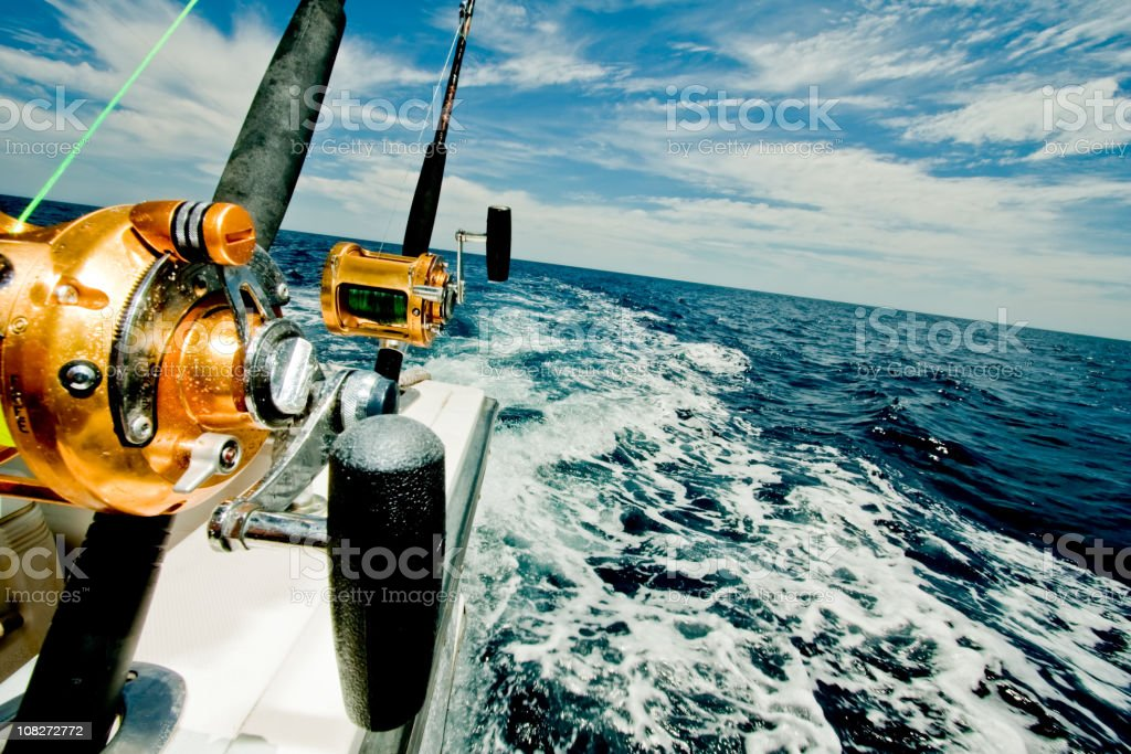 Big Game Fishing Reels on a Boat in the Ocean stock photo