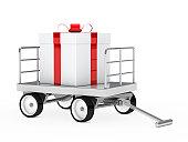 istock big gift on trolley 150863460