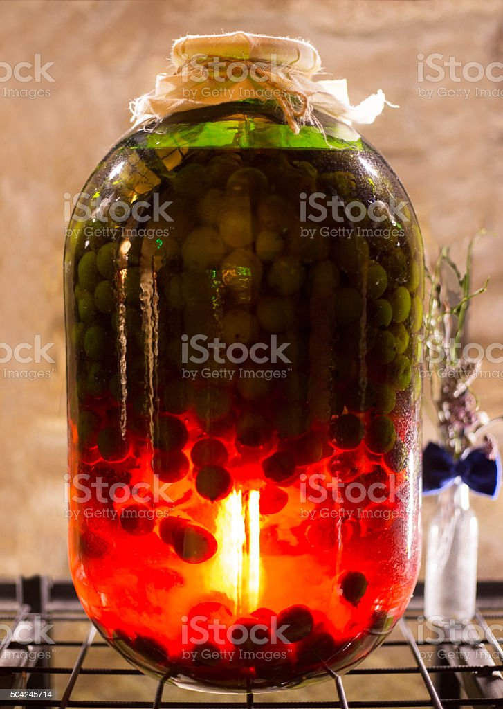 Big glass bank with berries stock photo