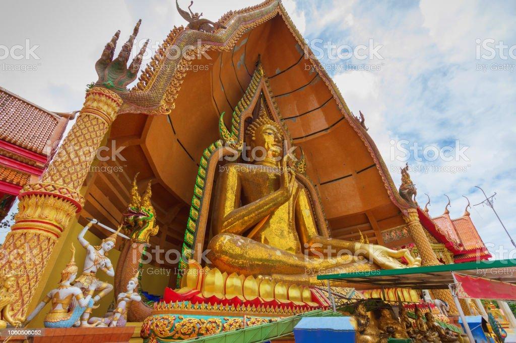 big gold Buddha statue at thai temple stock photo
