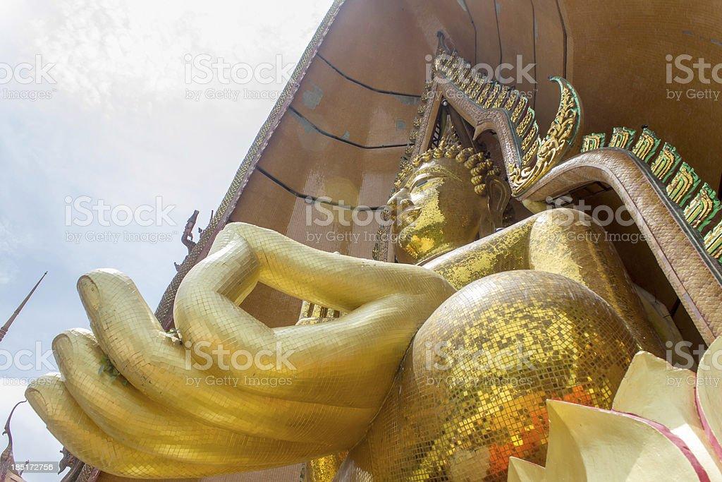 Big golden Buddha in temple, Kanchanaburi Thailand royalty-free stock photo