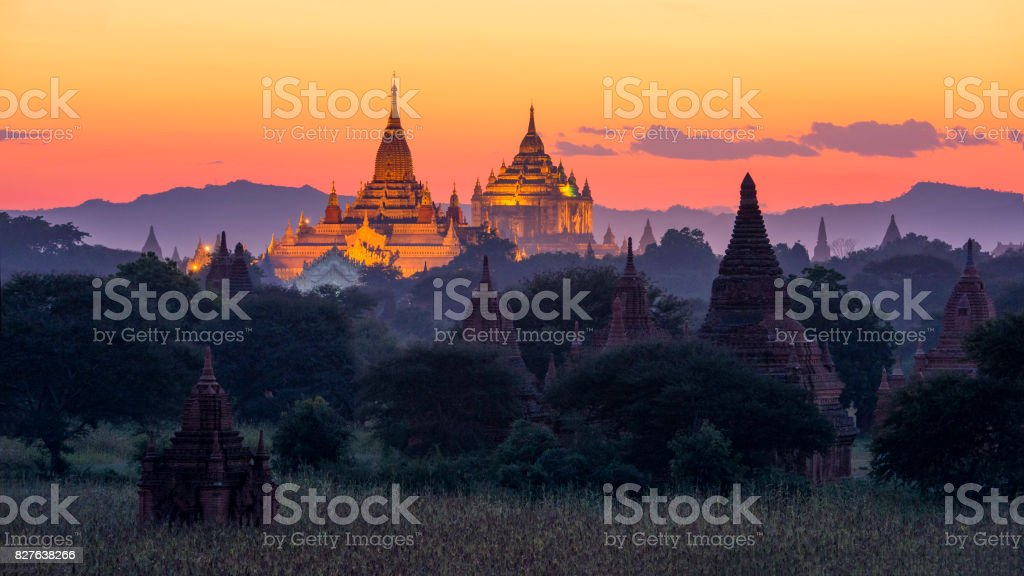 Big Golden Pagoda at Twilight with rice filed at Bagan, Myanmar stock photo