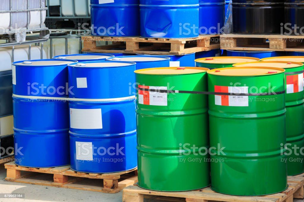 Big green and blue barrels on wooden pallets stock photo