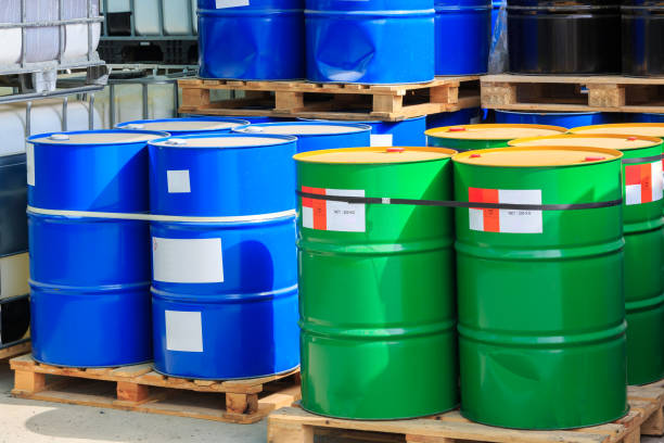 Big green and blue barrels on wooden pallets Big green and blue barrels standing on wooden pallets on a chemical plant hazardous chemicals stock pictures, royalty-free photos & images