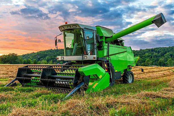 Big green one Big green combine harvester in sunset light agricultural equipment stock pictures, royalty-free photos & images