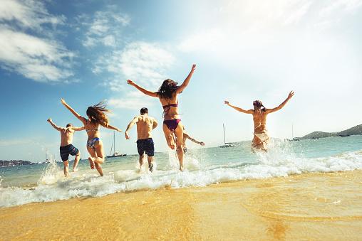 Big group friends beach run vacations