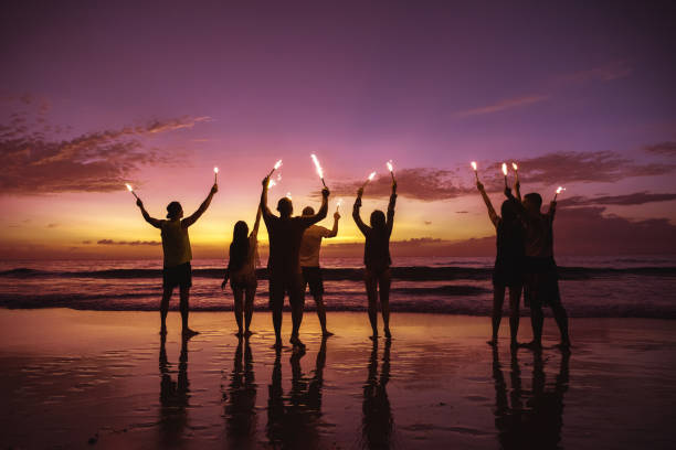 Big group friends with sparkle lights at beach picture id1134157949?b=1&k=6&m=1134157949&s=612x612&w=0&h=etfbdt3oc96feusi6gpsbbwa6uzmfa894pdvwoylu 4=